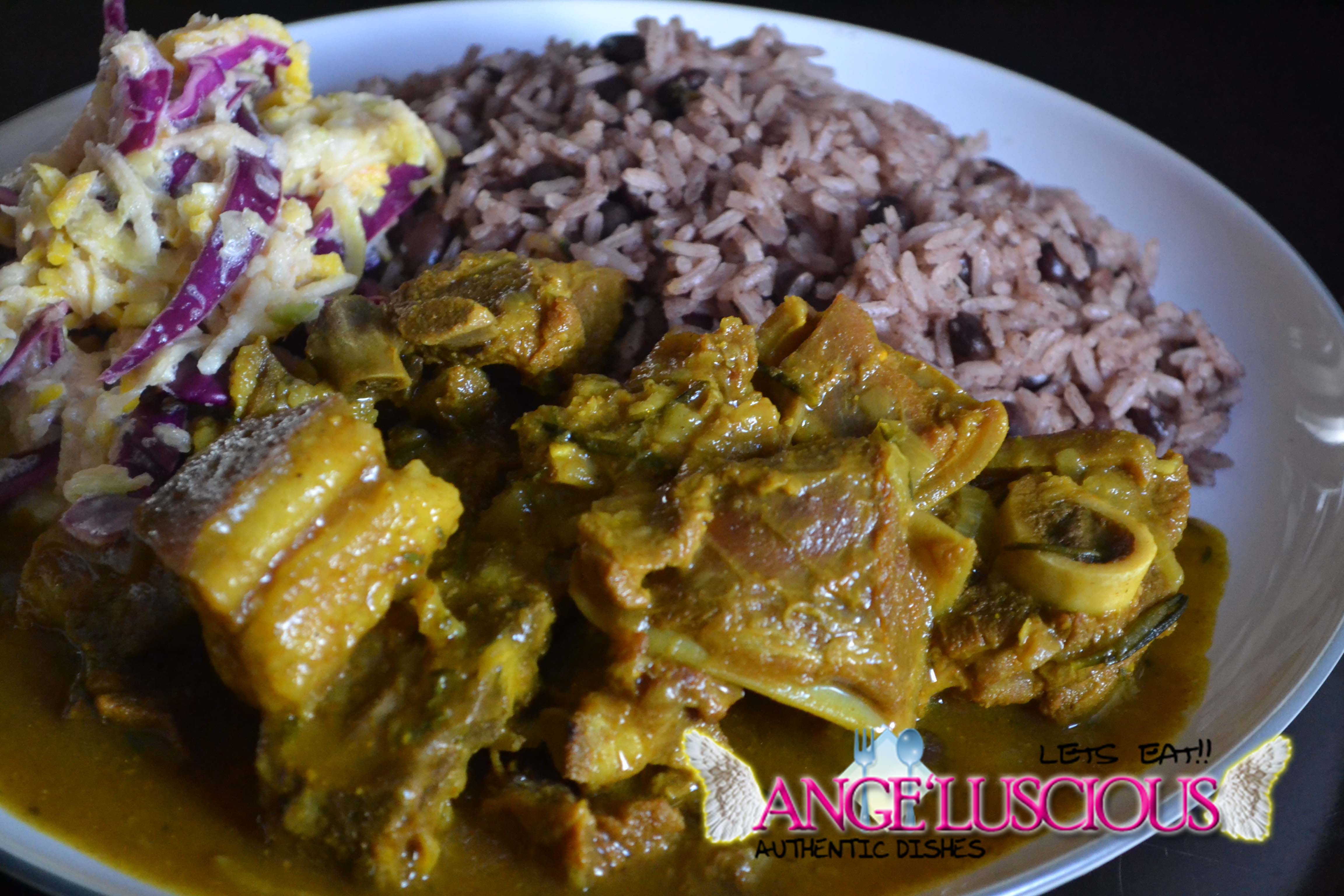 rosemary infused curry goat with rice and peas red kidney
